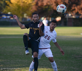 Cal State Los Angeles's Rigoberto Maciel (7) and Chico State's Eruvey Arceta (26) battle for the ball Thursday October 31, 2017 in Chico, California. (Emily Bertolino -- Enterprise-Record)