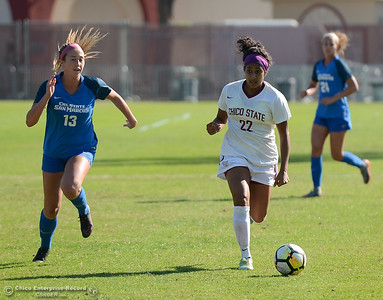 Chico State's Pooja Patel (22) and Can State San Marcos's Madyson Brown (13) race after the ball Thursday October 31, 2017 in Chico, California. (Emily Bertolino -- Enterprise-Record)