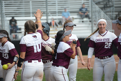 Chico State players high five each other, Friday, March 9, 2018, in Chico, California. (Carin Dorghalli -- Enterprise-Record)