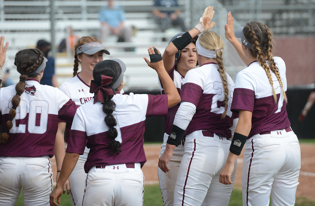 . Chico State players high five each other, Friday, March 9, 2018, in Chico, California. (Carin Dorghalli -- Enterprise-Record)