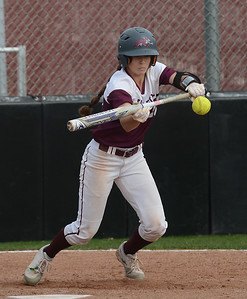 Chico State's Kristin Worley hits the ball, Friday, March 9, 2018, in Chico, California. (Carin Dorghalli -- Enterprise-Record)