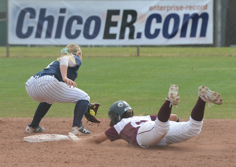 Chico State's Ari Marsh slides toward the plate just in time as Monterey Bay's Jayme Stark tries to tag her, Friday, March 9, 2018, in Chico, California. (Carin Dorghalli -- Enterprise-Record)