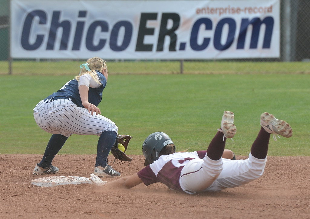 . Chico State\'s Ari Marsh slides toward the plate just in time as Monterey Bay\'s Jayme Stark tries to tag her, Friday, March 9, 2018, in Chico, California. (Carin Dorghalli -- Enterprise-Record)