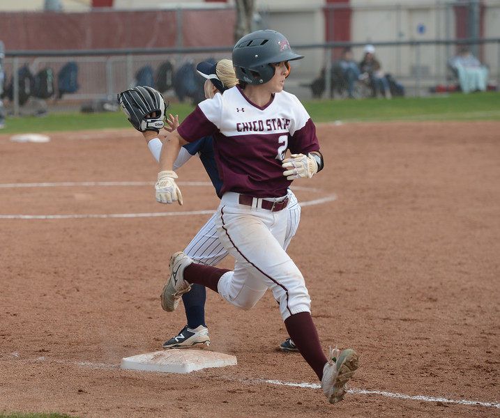 Chico State's Kristin Worley runs past the base as Monterey Bay's Courtney Hennings tries to catch the ball, Friday, March 9, 2018, in Chico, California. (Carin Dorghalli -- Enterprise-Record)