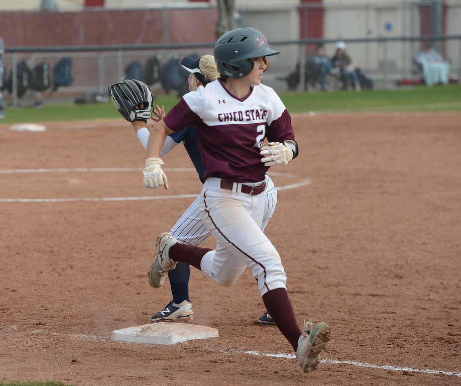 . Chico State\'s Kristin Worley runs past the base as Monterey Bay\'s Courtney Hennings tries to catch the ball, Friday, March 9, 2018, in Chico, California. (Carin Dorghalli -- Enterprise-Record)