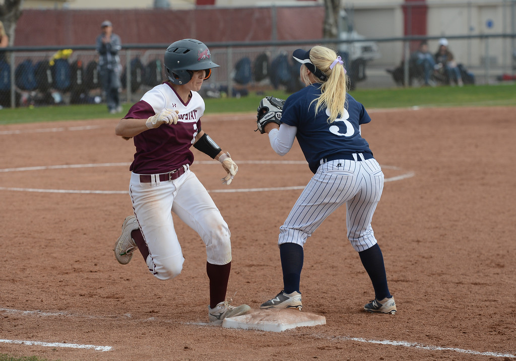 . Chico State\'s Kristin Worley runs to the base as Monterey Bay\'s Courtney Hennings tries to catch the ball, Friday, March 9, 2018, in Chico, California. (Carin Dorghalli -- Enterprise-Record)