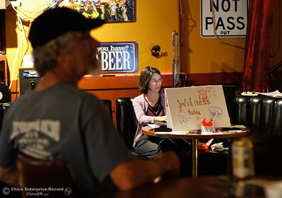 Elizabeth Quivey sits at the witness table logging song names and noting the time they start and stop Tuesday April 5, 2016 during the Guinness World Record breaking attempt Chico Strikes Back at the Down Lo in Chico, Calif. (Emily Bertolino -- Enterprise-Record)