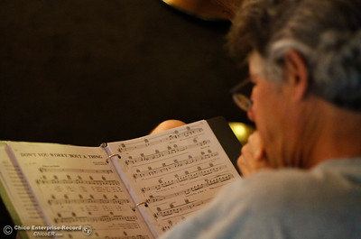 A man looks over sheet music as Chico Strike Back ensues Tuesday April 5, 2016 at the Down Lo in Chico, Calif. (Emily Bertolino -- Enterprise-Record)