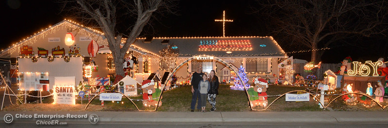 Left to right, Tim Tiffany, Ellie Tiffany, 10, and Kari Tiffany pose for a picture in front of their home Wednesday, Dec. 12, 2018, in Chico. The Tiffany's home is one of many on the Chico Tour of Lights this year. (Dan Reidel -- Enterprise-Record)