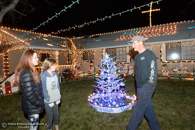 Left to right, Kari Tiffany, Ellie Tiffany and Tim Tiffany show off their Christmas light display Wednesday, Dec. 12, 2018, at the Tiffany home on the 500 block of Cimarron Drive. The family home is one of many on the 2018 Chico Tour of Lights in Chico, California. (Dan Reidel -- Enterprise-Record)