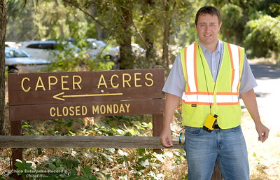 City of Chico Urban Forest Manager Richie Bamlet smiles beside a sign in Bidwell Park near Caper Acres Tuesday, July 10, 2018. Bamlet wrote a grant application that landed a $426,000 grant from Cal Fire. The grant will help the city with a tree inventory, including checking and planting trees in Bidwell Park.  (Bill Husa -- Enterprise-Record)