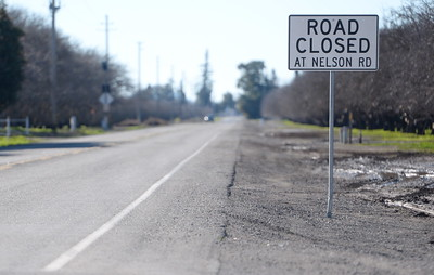 A sign posted on Durham Dayton highway says Road Closed at Nelson Road Friday but  some Chico area roads have been re-opening after flooding during the storm last week. Friday, Jan. 13, 2017. (Bill Husa -- Enterprise-Record)