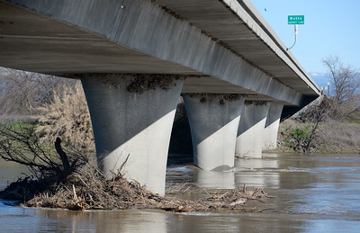 Debris piles up on the Hwy 32 bridge over the Sacramento River Friday, Jan. 13, 2017. It appears the river has receded a bit today. (Bill Husa -- Enterprise-Record)
