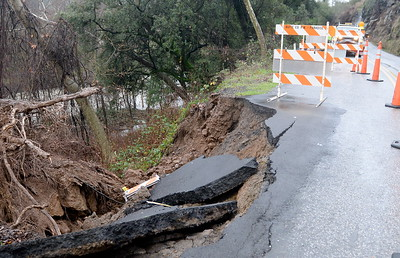 Butte County Public Works Crews block off a lane of Centerville Road after a large tree fell late Monday afternoon taking a substantial chunk of the road with it. Crews were arriving on scene shortly after this photo was taken Tues. Jan. 10, 2017. (Bill Husa -- Enterprise-Record)
