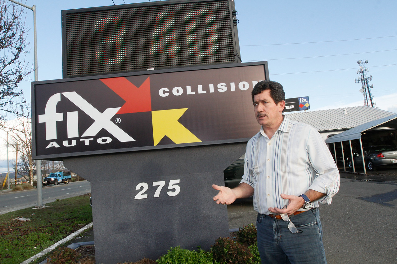 Local business owner Mark Page talks about the digital sign he recently installed in front of his shop Fix Auto, formerly Chico Collision Center, on East Park Avenue Wednesday January 11, 2017 in Chico, California. (Emily Bertolino -- Enterprise-Record)