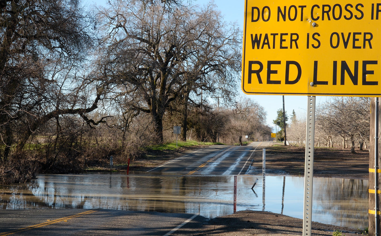 The dips along Ord Ferry Road are often contemplated by drivers who must decide whether or not they think they can make it. Road Closed signs are posted along Ord Ferry Rd. Friday however some Chico area roads have been re-opening after flooding during the storm last week. Friday, Jan. 13, 2017. (Bill Husa -- Enterprise-Record)