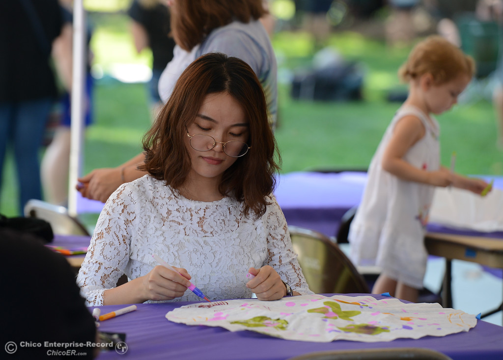 . Jiayu Yang makes a hat at an art booth during the Chico World Music Festival Saturday September 9, 2017 at CSUC in Chico, California. (Emily Bertolino -- Enterprise-Record)