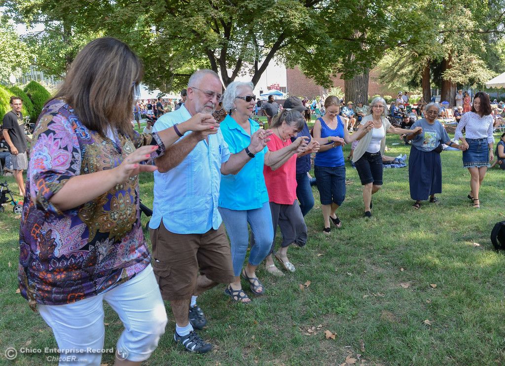 . A group forms and dances to the music of Balkalicious Fire Drive during the Chico World Music Festival Saturday September 9, 2017 at CSUC in Chico, California. (Emily Bertolino -- Enterprise-Record)