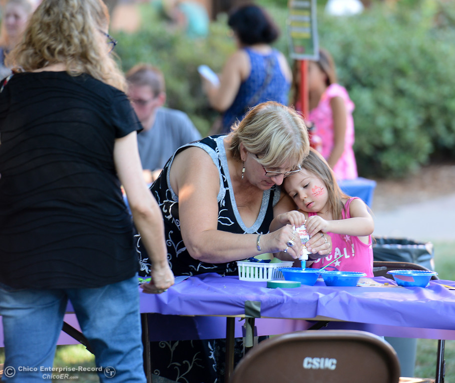 . Pam Bodnar and her daughter Millie, 3, work on an art project during the Chico World Music Festival Saturday September 9, 2017 at CSUC in Chico, California. (Emily Bertolino -- Enterprise-Record)