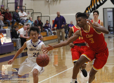 Chico High's Kaden Bradley reaches in to try to steal the ball away from Oroville's Kody Thao during a boys basketball January 3, 2017 in Oroville California. (Emily Bertolino -- Enterprise-Record)