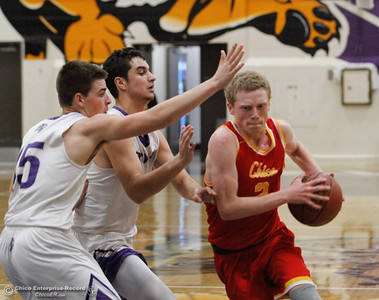 Chico High's Brenden Bohannon drives towards the basket past Oroville's Kyle Kroeger and Hunter Monnot, left to right,   during a boys basketball January 3, 2017 in Oroville California. (Emily Bertolino -- Enterprise-Record)