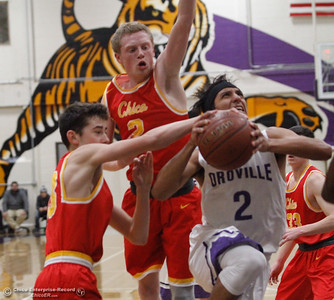 Oroville High's Ryan Lowe goes up to shoot as Chico High's Ethan Hamel and Brenden Bohannon, left to right, try to stop him during a boys basketball January 3, 2017 in Oroville California. (Emily Bertolino -- Enterprise-Record)