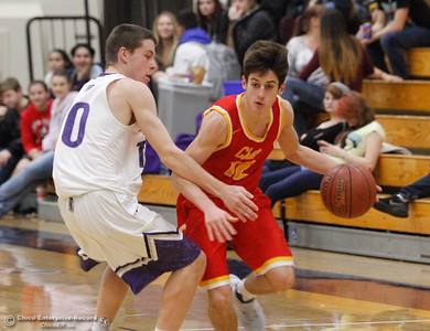 Chico High's Tyler Willis drives down the court as Oroville's Isaac Hutcheson plays tough defense during a boys basketball January 3, 2017 in Oroville California. (Emily Bertolino -- Enterprise-Record)