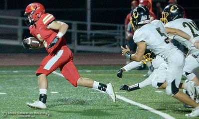 Chico's Ty Walker breaks out for some yards while Enterprise's Anthony Norman (5) and Justin Kelly (24) give chase during PV vs Shasta High Football at University Stadim in Chico, Calif. Friday Sept. 28, 2018.  (Bill Husa -- Enterprise-Record)