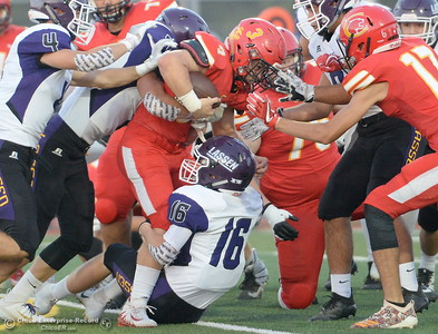 Chico #3 Bobby McCoy fights for yards as Lassen #16 Aaron Ogburn drags him down during Chico High vs Lassen High School varsity football action at Chico, Calif. Friday Aug. 31, 2018.  (Bill Husa -- Enterprise-Record)