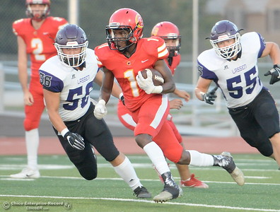 Chico #1 Anthony Thomas runs past Lassen #55 Aiden Phillips and #56 Doug Forrester during first quarter acrtion of Chico High vs Lassen High School varsity football action at Chico, Calif. Friday Aug. 31, 2018.  (Bill Husa -- Enterprise-Record)
