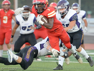 Chico #1 Anthony Thomas runs through a tackle by Lassen #7 Matt Rudd during first quarter acrtion of Chico High vs Lassen High School varsity football action at Chico, Calif. Friday Aug. 31, 2018.  (Bill Husa -- Enterprise-Record)