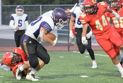 Chico #1 Anthony Thomas and #44 Ramon Campos close in on the tackle of Lassen #40 Tucker St. Andre during Chico High vs Lassen High School varsity football action at Chico, Calif. Friday Aug. 31, 2018.  (Bill Husa -- Enterprise-Record)