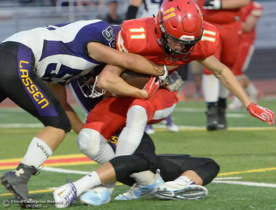 Chico #11Abe Del Real fights for yards during Chico High vs Lassen High School varsity football action at Chico, Calif. Friday Aug. 31, 2018.  (Bill Husa -- Enterprise-Record)