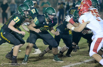Paradise's Blake White (51) and Josh Alvies (31) battle in the trenches as Chico's Bobby McCoy (3) looks for the ball carrier during Paradsise vs Chico football at Paradise High Friday, Oct. 5, 2018.   (Bill Husa -- Enterprise-Record)