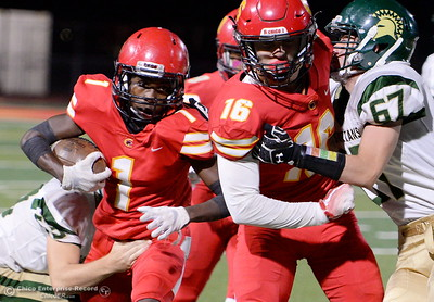 Chico's Anthony Thomas (1) tries to break a tackle as he follows the block of Kobe Hood (16) against Red Bluff's Lane Raschke (67) during Chico vs Red Bluff football at Chico Calif. Friday Oct. 12, 2018. (Bill Husa -- Enterprise-Record)