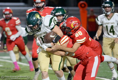Chico defenders nearly cause a fumble by Red Bluff's William Strider (15) on this play during Chico vs Red Bluff football at Chico Calif. Friday Oct. 12, 2018. (Bill Husa -- Enterprise-Record)