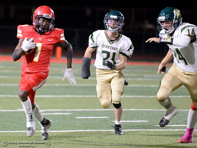 Chico's Anthony Thomas (1) runs away from Red Bluff's Joey Estrada (21) and Trevor Kinsworthy (14) as he gets to the outside on this play during Chico vs Red Bluff football at Chico Calif. Friday Oct. 12, 2018. (Bill Husa -- Enterprise-Record)