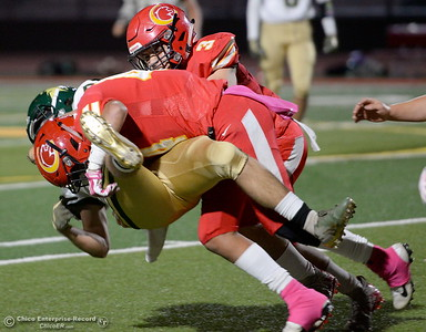 Chico's Ramon Campos (44) with some help from Bobby McCoy (3) upends a Red Bluff ball carrier during Chico vs Red Bluff football at Chico Calif. Friday Oct. 12, 2018. (Bill Husa -- Enterprise-Record)