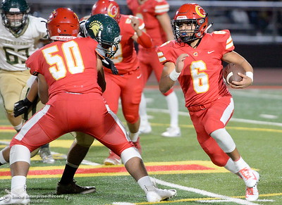 Chico's Jalen Johnson (6) gets a nice block from Ernesto Gonzalez (50) as he gets around the corner on this run during Chico vs Red Bluff football at Chico Calif. Friday Oct. 12, 2018. (Bill Husa -- Enterprise-Record)