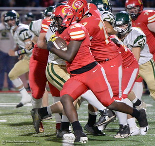 Chico's Cory Jones-Mann (25) breaks tackles midfield during Chico vs Red Bluff football at Chico Calif. Friday Oct. 12, 2018. (Bill Husa -- Enterprise-Record)