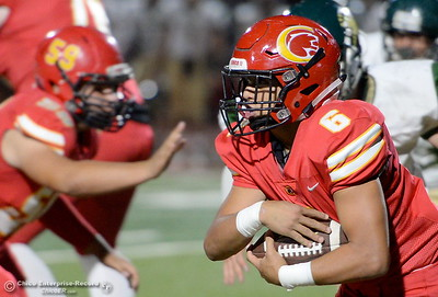 Chico's Jalen Johnson jangs onto the ball as he looks for room to run during Chico vs Red Bluff football at Chico Calif. Friday Oct. 12, 2018. (Bill Husa -- Enterprise-Record)