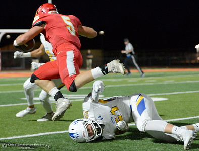 Chico #5 Ty Walker leaps over Sutter #21 Kyle Macy near the sidelines during first half action of Chico vs Sutter football at Chico Friday, Sept. 14, 2018.  (Bill Husa -- Enterprise-Record)