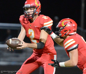 Chico QB #2 Ty Thomas hands off to #5 Ty Walker as Sutter #14 Kyle Watson applies pressure during first half action of Chico vs Sutter football at Chico Friday, Sept. 14, 2018.  (Bill Husa -- Enterprise-Record)
