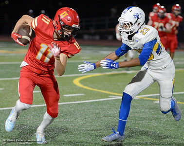 Chico #11 tries to round the corner past Sutter #23 Roman Resendez during first half action of Chico vs Sutter football at Chico Friday, Sept. 14, 2018.  (Bill Husa -- Enterprise-Record)