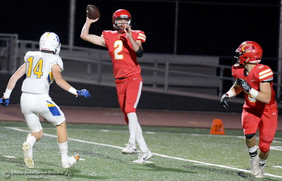 Chico QB #2 Ty Thomas flips it to #5 Ty Walker as Sutter #14 Kyle Watson applies pressure during first half action of Chico vs Sutter football at Chico Friday, Sept. 14, 2018.  (Bill Husa -- Enterprise-Record)