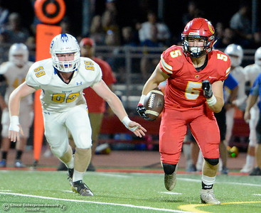 Chico #5 Ty Walker looks for some room to run as he is chased by Sutter #69 Travis Tedder during first half action of Chico vs Sutter football at Chico Friday, Sept. 14, 2018.  (Bill Husa -- Enterprise-Record)