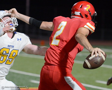 Chico QB #2 Ty Thomas straghtarms Sutter #69Travis Tedder on this play during first half action of Chico vs Sutter football at Chico Friday, Sept. 14, 2018.  (Bill Husa -- Enterprise-Record)