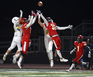 Several players from both teams jump for a bad pass by Sutter that turned into an interception by Chico #44 Ramon Campos on this play during first half action of Chico vs Sutter football at Chico Friday, Sept. 14, 2018.  (Bill Husa -- Enterprise-Record)