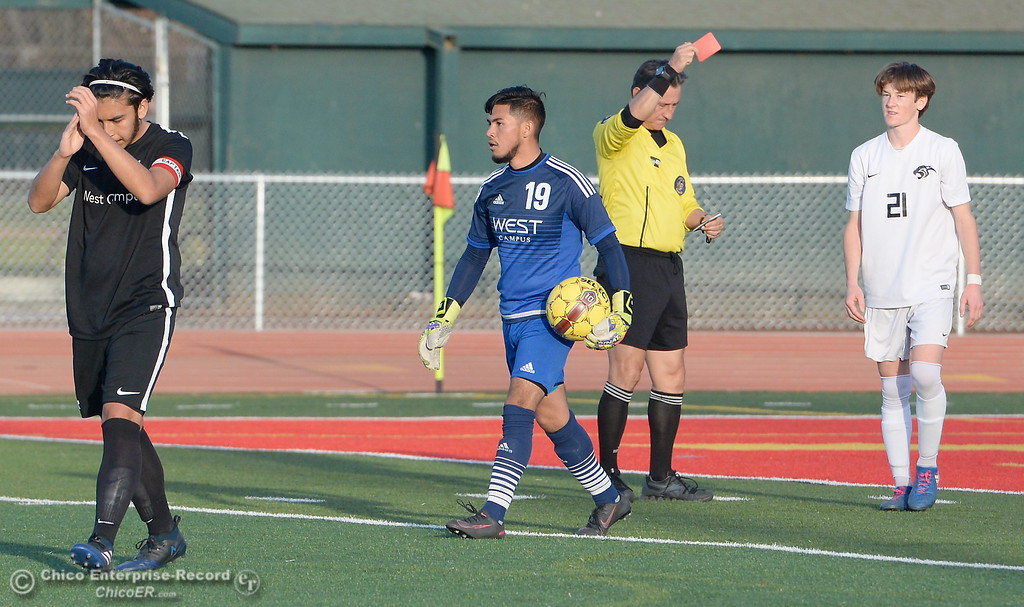 . Chico #21 Rory Monninger gets a red card during the first round of the NorCal state playoffs Chico High vs West Campus boys soccer at Chico, Tues. March 6, 2018. (Bill Husa -- Enterprise-Record)