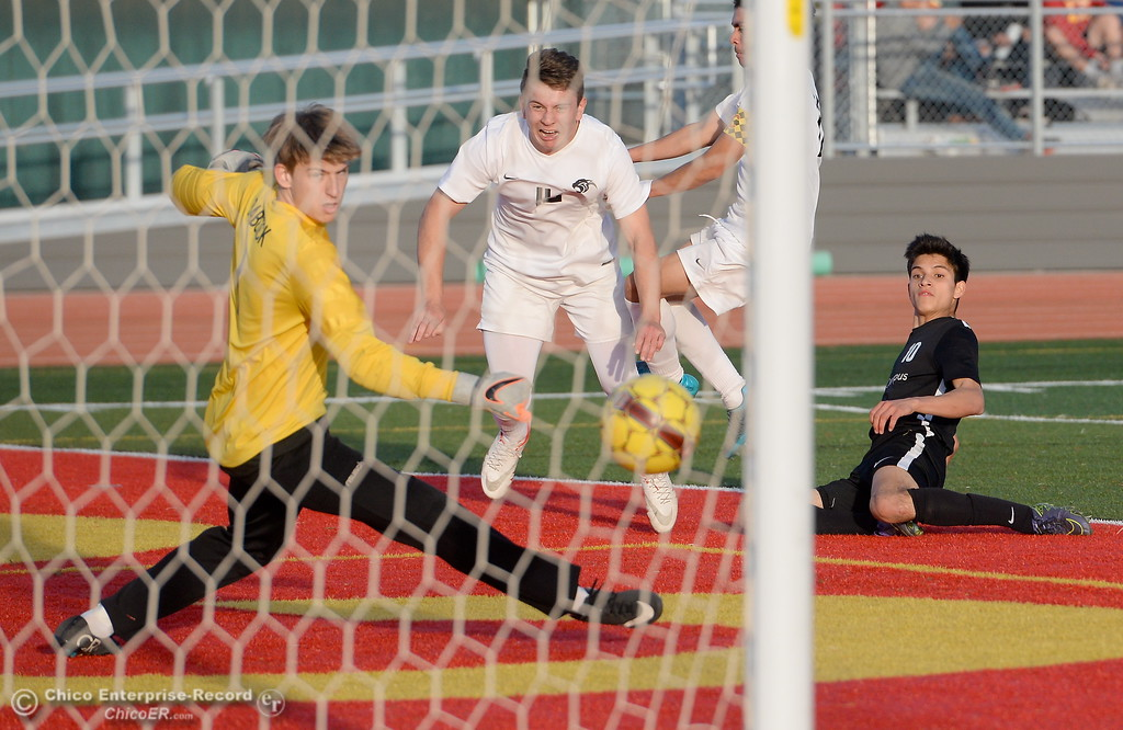 . Chico Goalie Duncan Babcock can\'t stop this shot by West Campus #10 Mateo Pasqua from going in the net for their second score during the first round of the NorCal state playoffs Chico High vs West Campus boys soccer at Chico, Tues. March 6, 2018. (Bill Husa -- Enterprise-Record)